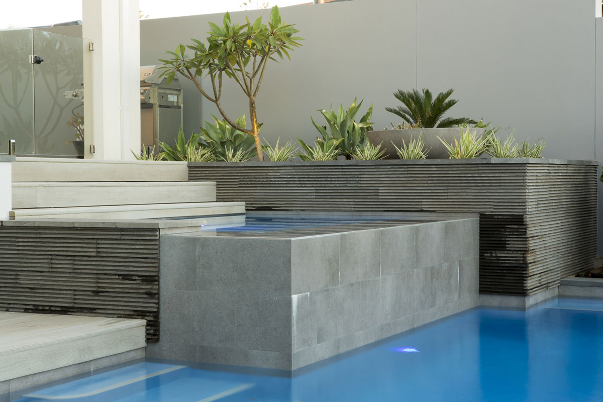 A combination of styles creates a unique landscaped pool in Perth
