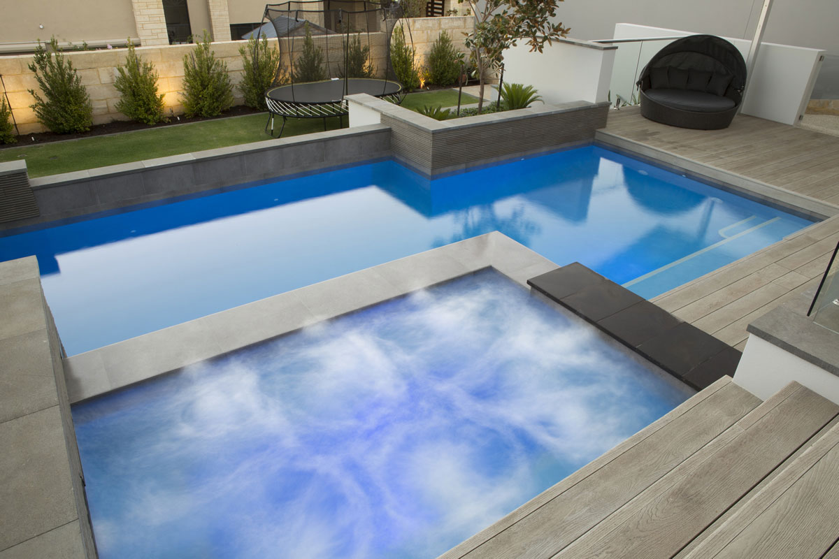 Pool and spa with decking and paving in Perth