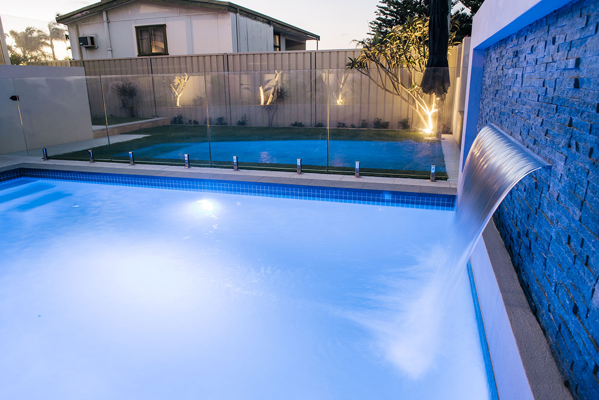 A water feature that adds a touch of class to a tranquil pool area