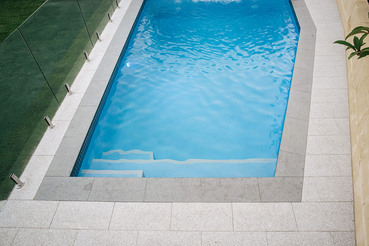 Unique pool design with professional paving in Perth